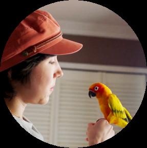 Photograph of Kathleen holding a bird